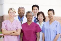 hospital staff standing outside a hospital